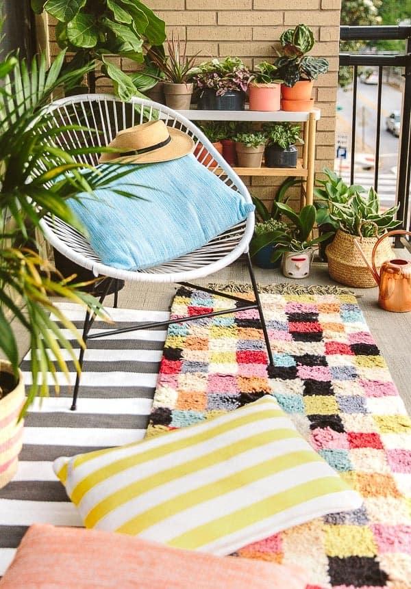 stylish acapulco chair on balcony