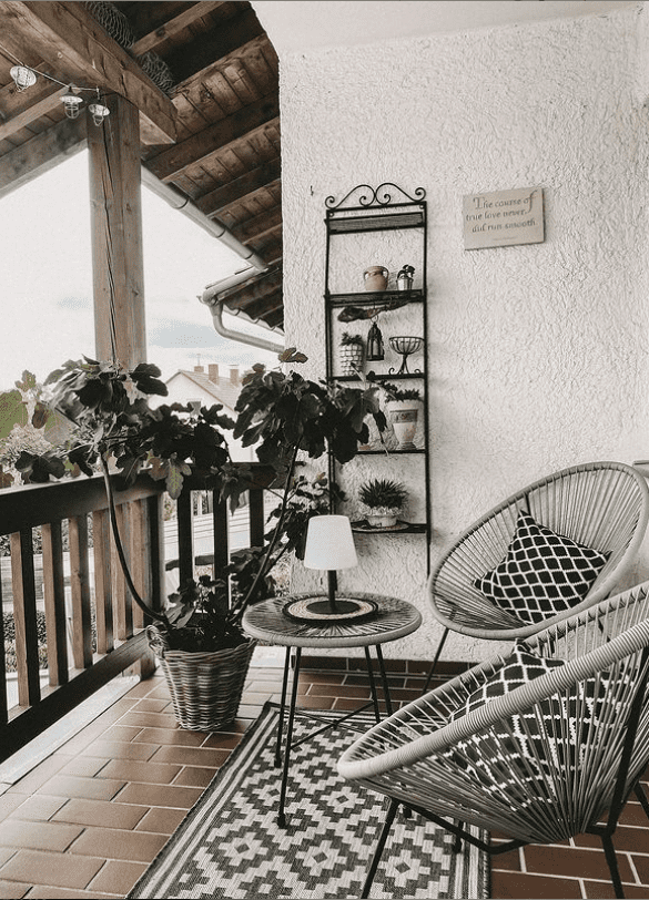 pair of acapulco chairs on balcony