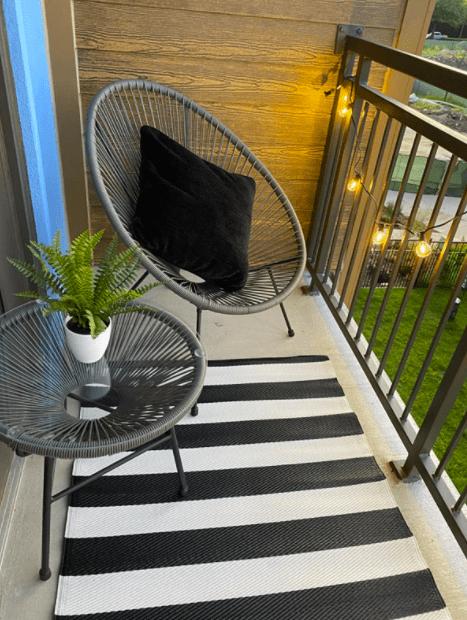 acapulco chair on tiny balcony