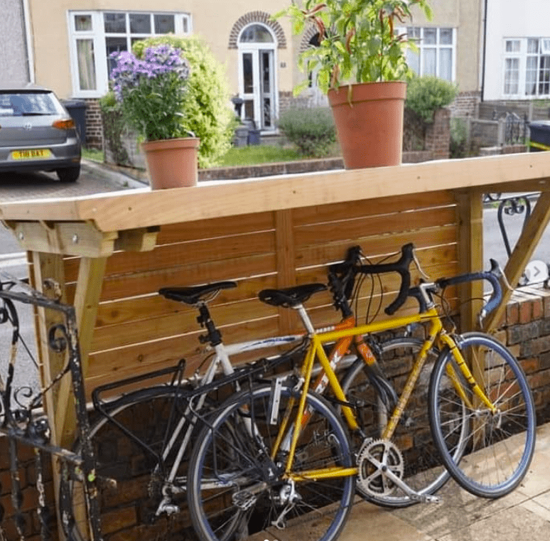 bicycle stored under balcony furniture