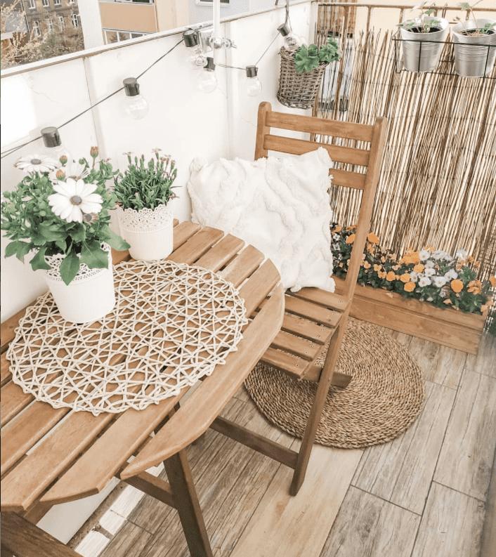 small folding table on narrow balcony
