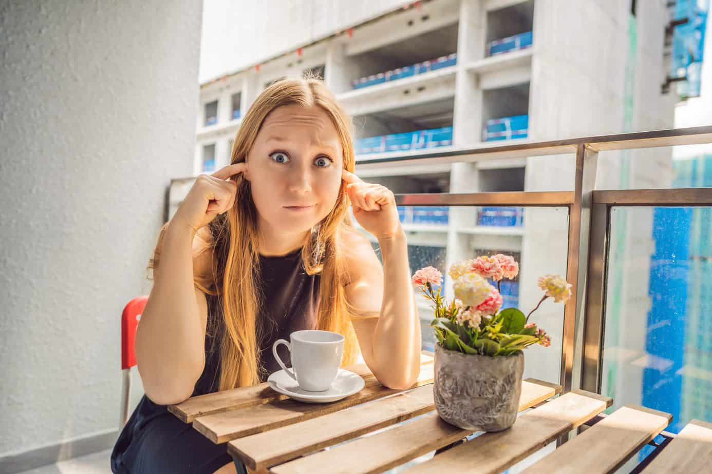 girl bothered by balcony noise